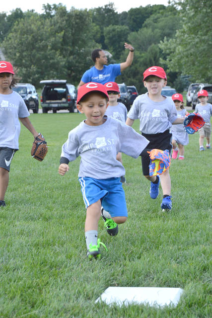 The entire Gray team from the Jump Start Beavercreek T-Bird T-Ball League learns to run the bases, June 27 at Rotary Park.