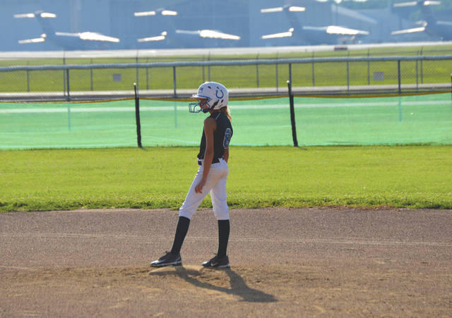 With Wright-Patterson Air Force Base in the background, Chloe Glass of the Springfield-based Strike Zone Fillies looks in from second base, during June 28 play in the USA Girls Softball Fairborn League at Fairfield Park in Fairborn.