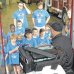 Campers visit heros in community