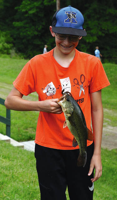 "Barb Slone | Greene County News Kids ages 6-14 went fishing May 26 during Greene County Parks & Trails' annual ""School's Out"" fishing derby at Spring Lakes Park in Bellbrook. Awards were given for the largest fish caught and most fish caught."