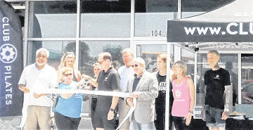 Submitted photo Owners Jeff and Lisa Shumway cut the ceremonial ribbon-cutting with help from Beavercreek Chamber of Commerce representative Brian Jarvis, Beavercreek Mayor Bob Stone and Greene County Commissioner Tom Koogler.