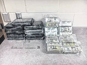 Large amounts of marijuana and more than $100,000 in cash were seized as part of the investigation.