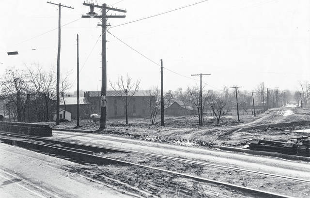 Courtesy of Greene County Historical Society Many side streets weren't paved as late as the 1930s, including Dayton Avenue at Orange Street, circa 1920s.