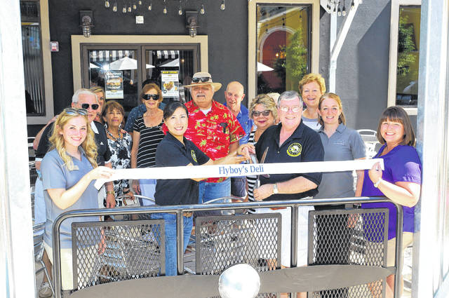 Barb Slone | Greene County News Flyboys at the Fairfield Commons Mall. They cut the ribbon Friday. Pictured are: Alexis Stiver, Mayor Bob Stone, Margaret Stone, John Sostrom, owners Eunice and Steve Crandall , Debborah Wallace, Susan Phillips, Dawn Mader and Beavercreek Chamber of Commerce President Amanda Byers.