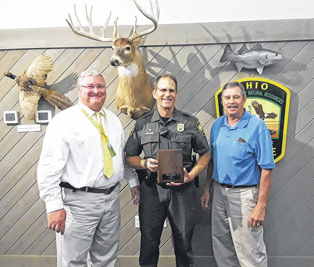 Submitted photo Officer Brain Goldick was awarded the Wildlife Officer of the Year for 2017. Presenting the award was (left) ODNR Division of Wildlife Chief Mike Miller, Officer Goldick, and Ohio Wildlife Council Chair Dr. Paul P. Mechling.