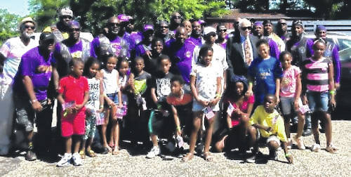Submitted photos Members of the Hawg Dawgs with 94-year-old Buffalo soldier Harold Warren Jr., members of the local chapter of the Omega Psi Phi Fraternity, Inc., park visitors and children from the STEM school.