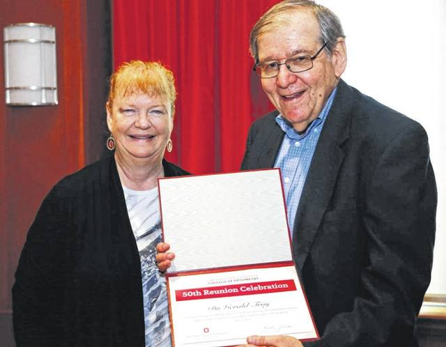 Submitted photo Dr. Gerald Troy, a retired Xenia optometrist, recently participated in a ceremony celebrating the 50th anniversary of his graduation from The Ohio State University College of Optometry in June 1968. Troy practiced optometry in Xenia from 1968 to 2005. Troy has received several honors including the <em>Xenia Daily Gazette</em> People&#8217;s Choice Award for &#8220;Best Optometric Care in Greene County&#8221; in 1997. Pictured with Troy is Dean Dr. Karla Zadnik.