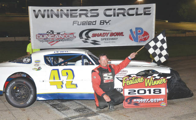 """Jim Lewis Jr., of Fairborn, poses for photos after a recent feature win at Shady Bowl Speedway. Lewis Jr.'s car was co-built by the late Bill """"Pappy"""" Lewis, who is being honored with a memorial race on Saturday, July 14 at the DeGraff, Ohio paved oval."""