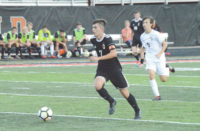 Senior midfielder Jonah Ackerson (7) scored the game's only goal in defending state champion Beavercreek's 1-0 home win Aug. 21 over Lebanon at Frank Zink Field in Beavercreek.