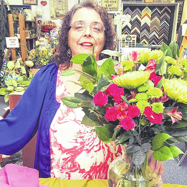 Submitted photo Owner Rose-Marie Bradley announces the addition of floral arrangements to Country Blessings.