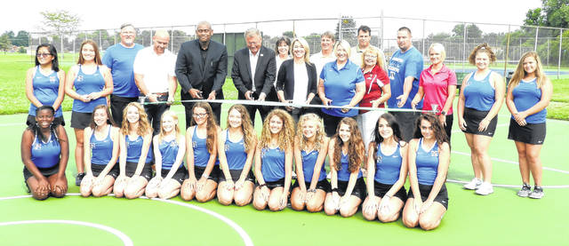Local officials join Xenia High School's women's tennis team in a ribbon cutting ceremony, Aug. 10, to recognize newly-resurfaced tennis courts at GCP&T's Fairgrounds Recreation Center. The courts include new lining for pickle ball, and the parks' basketball court was also rehabbed.