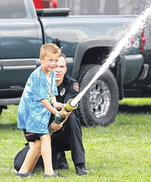 Barb Slone | Greene County News Spring Valley Township Fire Department helped local youth try out the Junior Firefighter Challenge at the Greene County Fair Aug. 4.