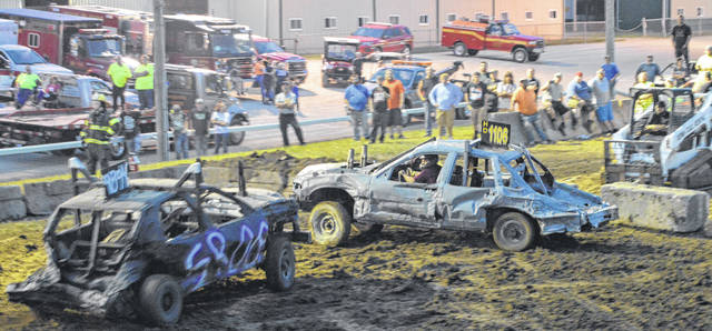 Shane Sprinkle of Springfield, in car no. 1106, braces for a hit from Lima's Brady Allen, during the Smash It Demolition Derby Kicker Car competition, July 30 at the Greene County Fair.