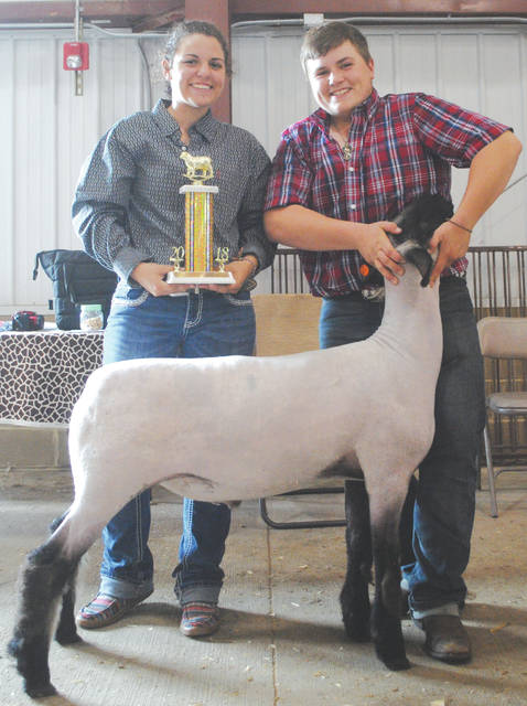 Whitney Vickers | Greene County News Luke Dean, a 9-year fair participant (right) and his girlfriend, Courtney Smart, holding his trophy.