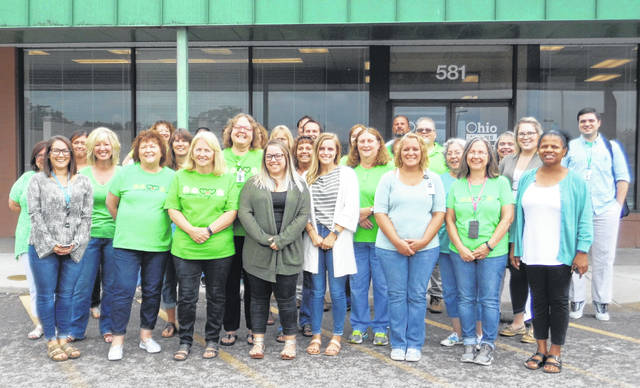 Submitted photo Employees of Greene County Department of Job & Family Services wear green on Aug.1 in recognition of Child Support Awareness Month.