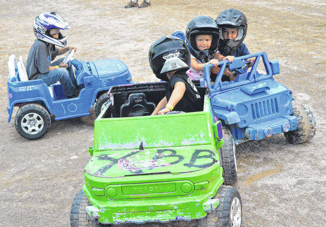 John Bombatch | Greene County News Tommy Donovon (left) of Xenia and (front) Kenny Pollock of Xenia battle it out at the Kiddie Demo Derby July 30.