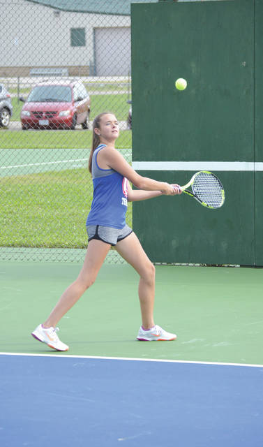 Greeneview freshman Zoe Sears hits a high backhand during warmups Wednesday Sept. 12 on the Greene County Fairgrounds tennis courts in Xenia. Sears and the rest of the Rams claimed a 5-0 win over host Xenia.