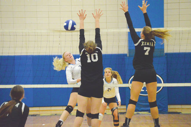 Fairborn's Darby Ballard (left) tries to hit past the block of Xenia's Camille Hughes (10) and Heidi Alex (7), during Tuesday's girls high school volleyball match at Xenia High School. Xenia rallied to win the match in four sets.