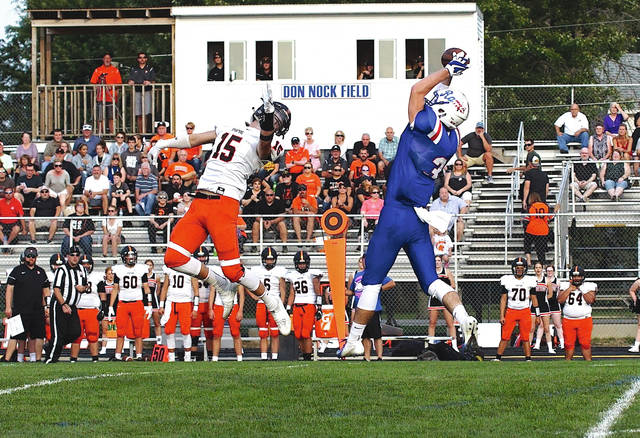 Greeneview senior Collin Wilson makes a nice grab of a pass as Waynesville's Hunter Fillmore tries to tip it away during week two action Aug. 31, at Don Nock Field in Jamestown. Greeneview beat Waynesville, 40-8.